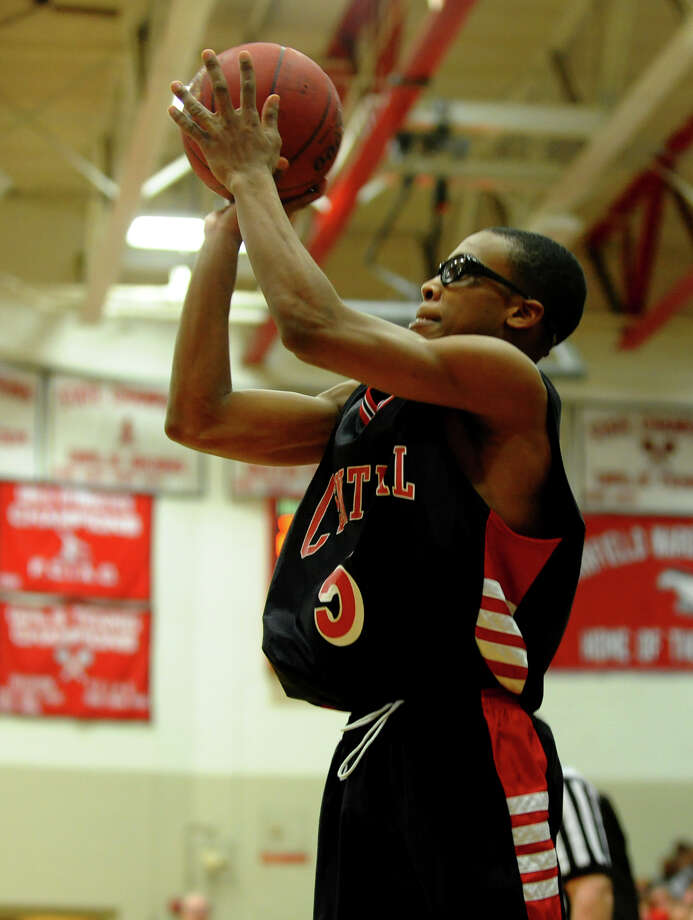 Central's #5 Dondre Daniels looks to score, during FCIAC boys basketball semifinals action against St. Joseph in Fairfield, Conn. on Tuesday February 26, 2013. Photo: Christian Abraham / Connecticut Post