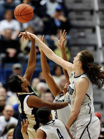 Connecticut's Breanna Stewart, right, blocks a shot by Pittsburgh's Ashlee Anderson, left, as Connecticut's Moriah Jefferson (4) and Morgan Tuck (3) defend during the first half of an NCAA college basketball game in Hartford, Conn., Tuesday, Feb. 26, 2013. (AP Photo/Jessica Hill) Photo: Jessica Hill, Associated Press / FR125654 AP