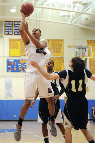 Bethel's Daniel Garvin (22) shoots over Notre Dame Fairfield defenders Jaylen Jennings (20) and Jake Heaton (11) during Bethel's 75-67 win over Notre Dame Fairfield in the semifinal game of the South-West Conference Boys High School Basketball Tournament at Newtown High School in Newtown, Conn. on Tuesday, Feb. 26, 2013. Garvin led Bethel with with 30 points, 23 rebounds and seven blocks. Photo: Tyler Sizemore / The News-Times