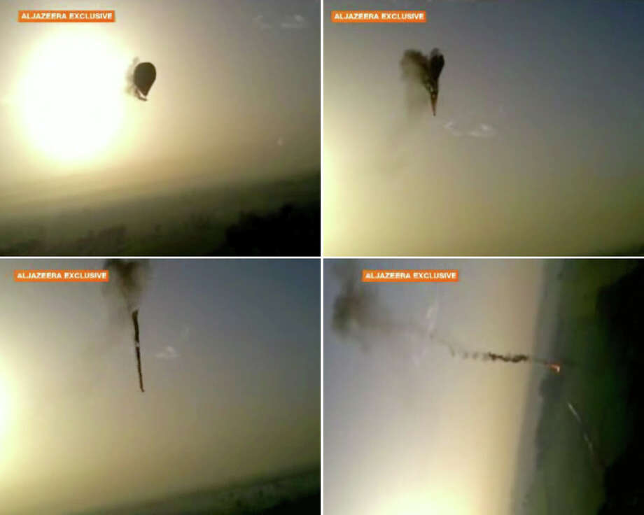In this combo made from images from amateur video provided by Al-Jazeera, smoke pours from a hot air balloon over Luxor, Egypt, top left, before bursting, top right, and plummeting about 1,000 feet to earth, bottom left and right, on Tuesday, Feb. 26, 2013. Nineteen people were killed in what appeared to be the deadliest hot air ballooning accident on record. A British tourist and the Egyptian pilot, who was badly burned, were the sole survivors. (AP Photo/Al-Jazeera) MANDATORY CREDIT: AL-JAZEERA Photo: Uncredited