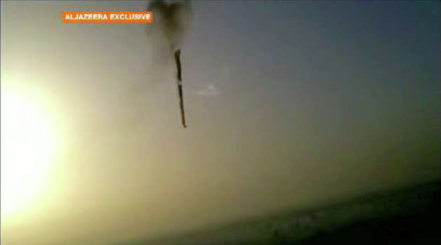 In this image taken from amateur video provided by Al-Jazeera, a hot air balloon over Luxor, Egypt plummets about 1,000 feet to earth on Tuesday, Feb. 26, 2013. Nineteen people were killed in what appeared to be the deadliest hot air ballooning accident on record. A British tourist and the Egyptian pilot, who was badly burned, were the sole survivors. (AP Photo/Al-Jazeera) MANDATORY CREDIT: AL-JAZEERA Photo: Uncredited
