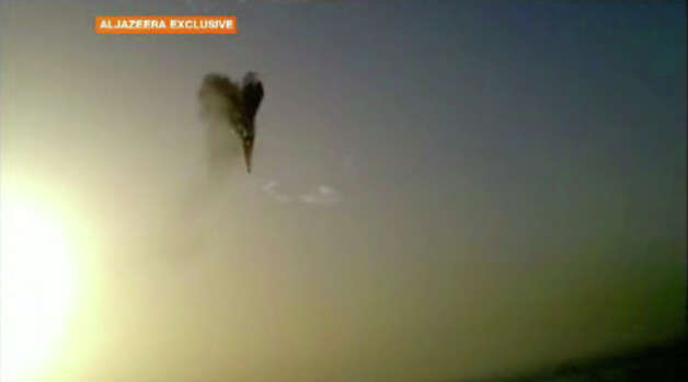 In this image taken from amateur video provided by Al-Jazeera, a hot air balloon over Luxor, Egypt bursts before plummeting about 1,000 feet to earth on Tuesday, Feb. 26, 2013. Nineteen people were killed in what appeared to be the deadliest hot air ballooning accident on record. A British tourist and the Egyptian pilot, who was badly burned, were the sole survivors. (AP Photo/Al-Jazeera) MANDATORY CREDIT: AL-JAZEERA Photo: Uncredited