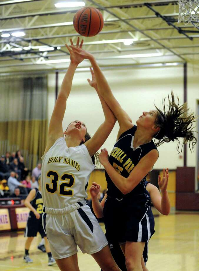 Holy Names Hannah Friend goes in for a score defended by Averill Park's Kelly Donnelly during their Class A Section II girl's basketball semifinal on Tuesday Feb. 26, 2013 in Colonie, N.Y. (Michael P. Farrell/Times Union) Photo: Michael P. Farrell