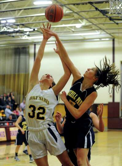 Holy Names Hannah Friend goes in for a score defended by Averill Park's Kelly Donnelly during their