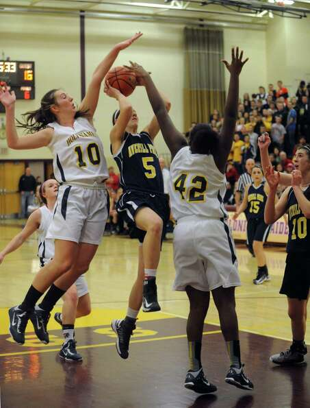 Averill Park's Kelly Donnelly drives to the basket during their Class A Section II girl's basketball