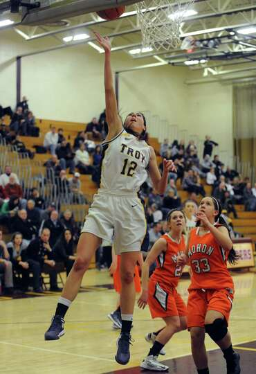 Troy's Courtney Avery goes in for a score during their Class A Section II girl's basketball semifina