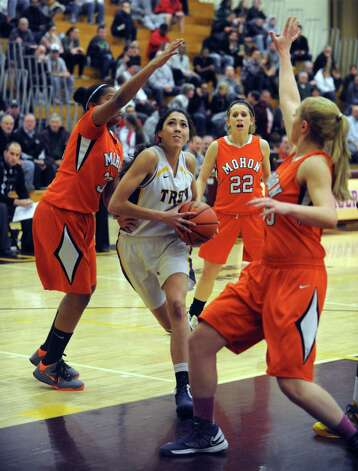 Troy's Courtney Avery drives to the basket during their Class A Section II girl's basketball semifinal against Mohonasen on Tuesday Feb. 26, 2013 in Colonie, N.Y. (Michael P. Farrell/Times Union) Photo: Michael P. Farrell