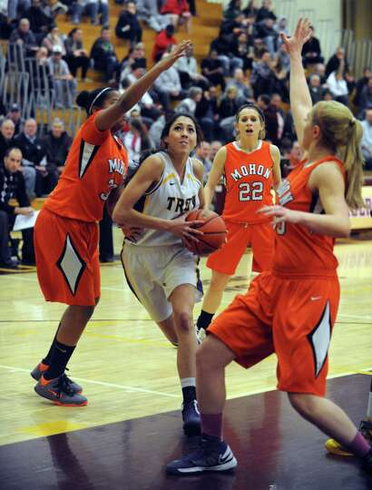Troy's Courtney Avery drives to the basket during their Class A Section II girl's basketball semifin