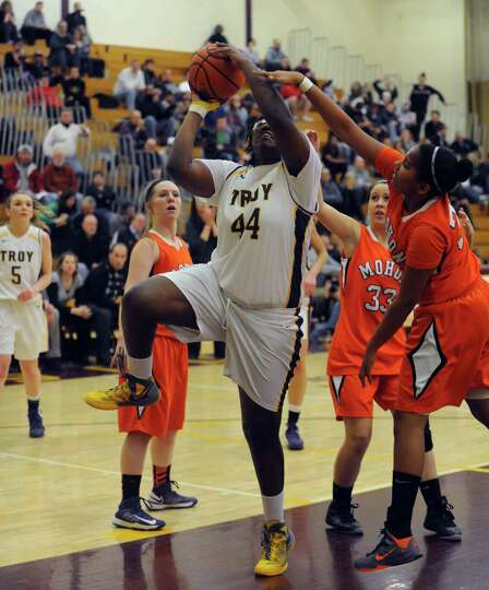 Troy's Cheyenne Williams drives to the basket during their Class A Section II girl's basketball semi