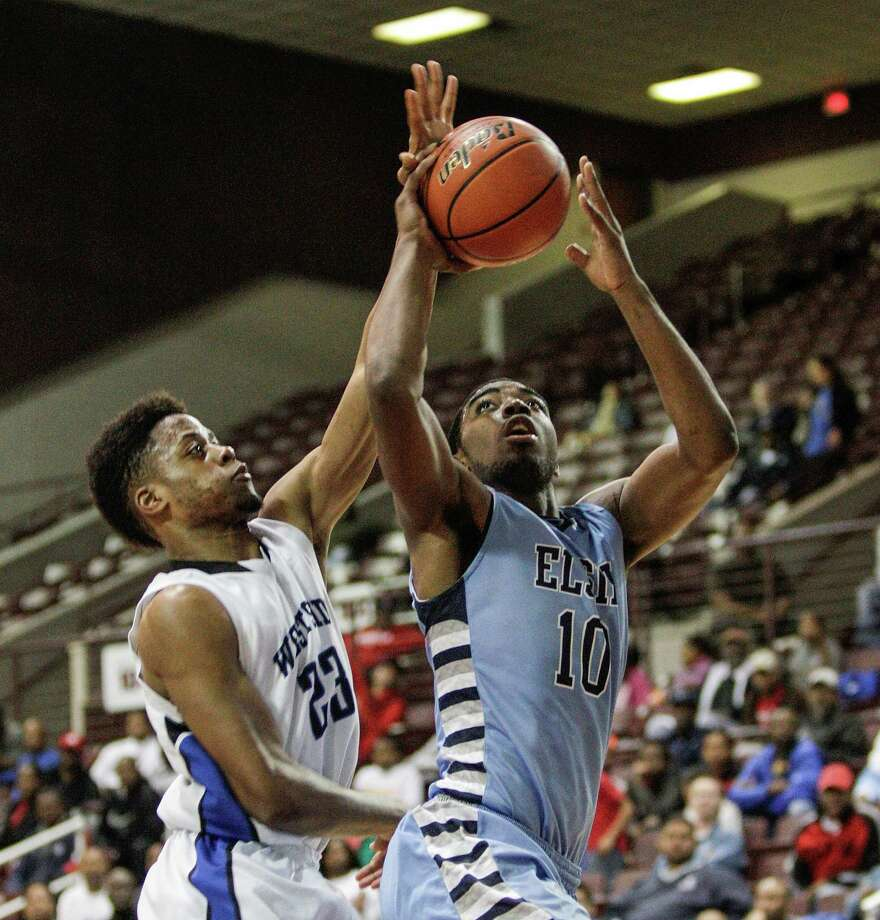 Westside 73, Elsik 66Westside forward Franklin Iheanacho, left, blocks a shot by Elsik's Caleb Bedford during Tuesday night's game at the Campbell Center. Photo: Bob Levey, Photographer / ©2013 Bob Levey