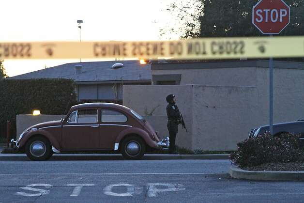 A police officer secures the shooting scene near N. Branciforte Avenue and Doyle Street Tuesday, Feb. 26, 2013 in Santa Cruz, Calif., where two Santa Cruz Police Detectives were shot and killed. The officers were killed while investigating a sexual assault, and a suspect was also fatally shot, authorities said. (AP Photo/Thomas Mendoza) Photo: Thomas Mendoza, Associated Press