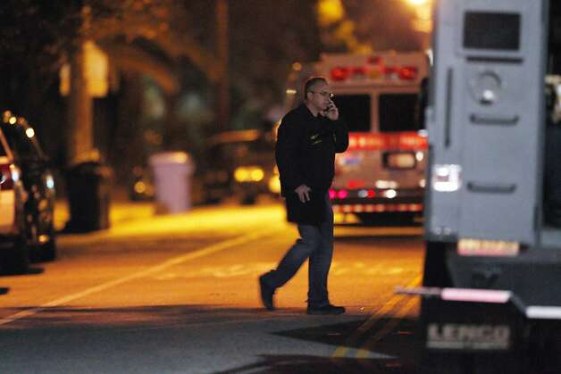 An investigator (unclear which agency)  speaks on the phone on N. Branciforte Avenue in Santa Cruz, Calif., on Tuesday night, February 26, 2013, after an officer involved shooting left two Santa Cruz police officers and a suspect dead near the intersection of Doyle Street and N. Branciforte Ave. Photo: Carlos Avila Gonzalez, The Chronicle