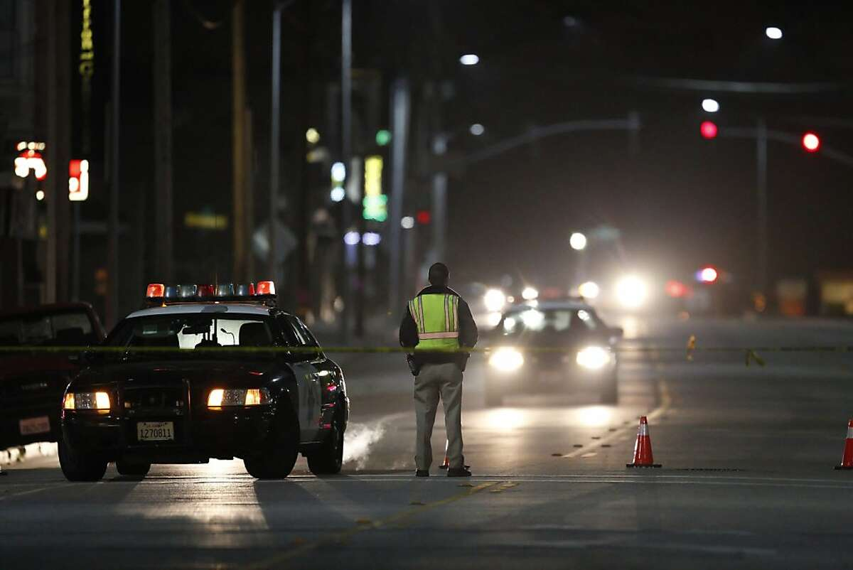 A CHP officer blocks Soquel Avenue near Doyle Street in Santa Cruz as police and the FBI investigate a shooting that left two SCPD officers and a suspect dead near the intersection of Doyle Street and N. Branciforte Ave.. Several police agencies blocked Doyle Street in Santa Cruz, Calif., on Tuesday night, February 26, 2013.