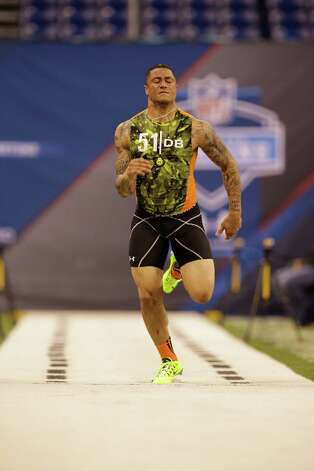 Texas defensive back Kenny Vaccaro runs the 40-yard dash at the NFL football scouting combine in Indianapolis, Tuesday, Feb. 26, 2013. Photo: Michael Conroy, Associated Press / AP