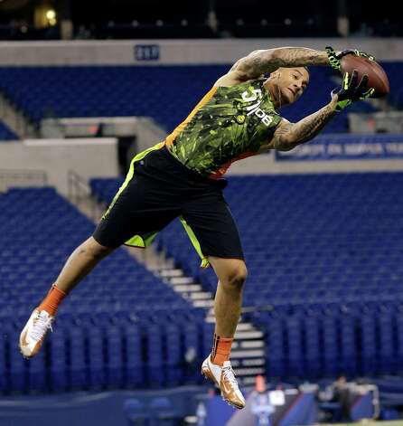Texas defensive back Kenny Vaccaro runs a drill during the NFL football scouting combine in Indianapolis, Tuesday, Feb. 26, 2013. Photo: Dave Martin, Associated Press / AP