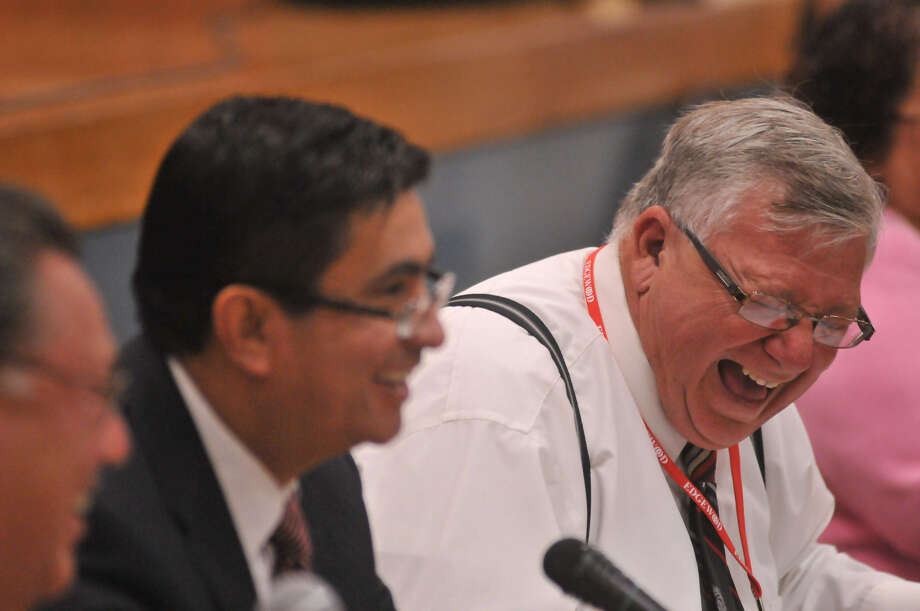 """Edgewood ISD President Joseph Guerra (right) and Superintendent Dr. Jose Cervantes share a light moment at Tuesday's board meeting. Guerra told city officials """"congratulations"""" after the district voted to join Pre-K 4 SA. Photo: Robin Jerstad / Special To The Express-News"""