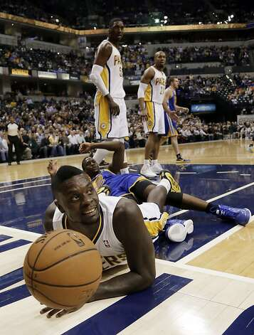 Indiana Pacers guard Lance Stephenson looks for the call from the official after diving after a ball while during the first half of an NBA basketball game against the Golden State Warriors in Indianapolis, Tuesday, Feb. 26, 2013. The Pacers won 108-97. (AP Photo/AJ Mast) Photo: Aj Mast, Associated Press