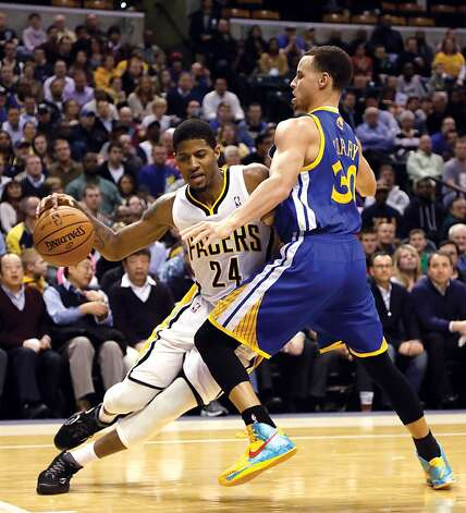 Indiana Pacers forward Paul George (24) goes around Golden State Warriors guard Stephen Curry during the second half of an NBA basketball game in Indianapolis, Tuesday, Feb. 26, 2013. The Pacers won 108-97. (AP Photo/AJ Mast) Photo: Aj Mast, Associated Press
