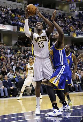 Indiana Pacers center Ian Mahinmi (28) shoots in front of Golden State Warriors center Festus Ezeli during the second half of an NBA basketball game in Indianapolis, Tuesday, Feb. 26, 2013. The Pacers won 108-97. (AP Photo/AJ Mast) Photo: Aj Mast, Associated Press