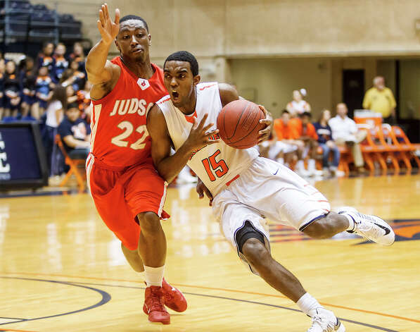 Brandeis' Justin Graham (right) tries to drive past Judson's Jarveon Williams during the second quarter of their Class 5A boys basketball third round game at the UTSA Convocation Center on Tuesday, Feb. 26, 2013.  Brandeis won the game 60-53. Photo: Marvin Pfeiffer, San Antonio Express-News / Express-News 2013