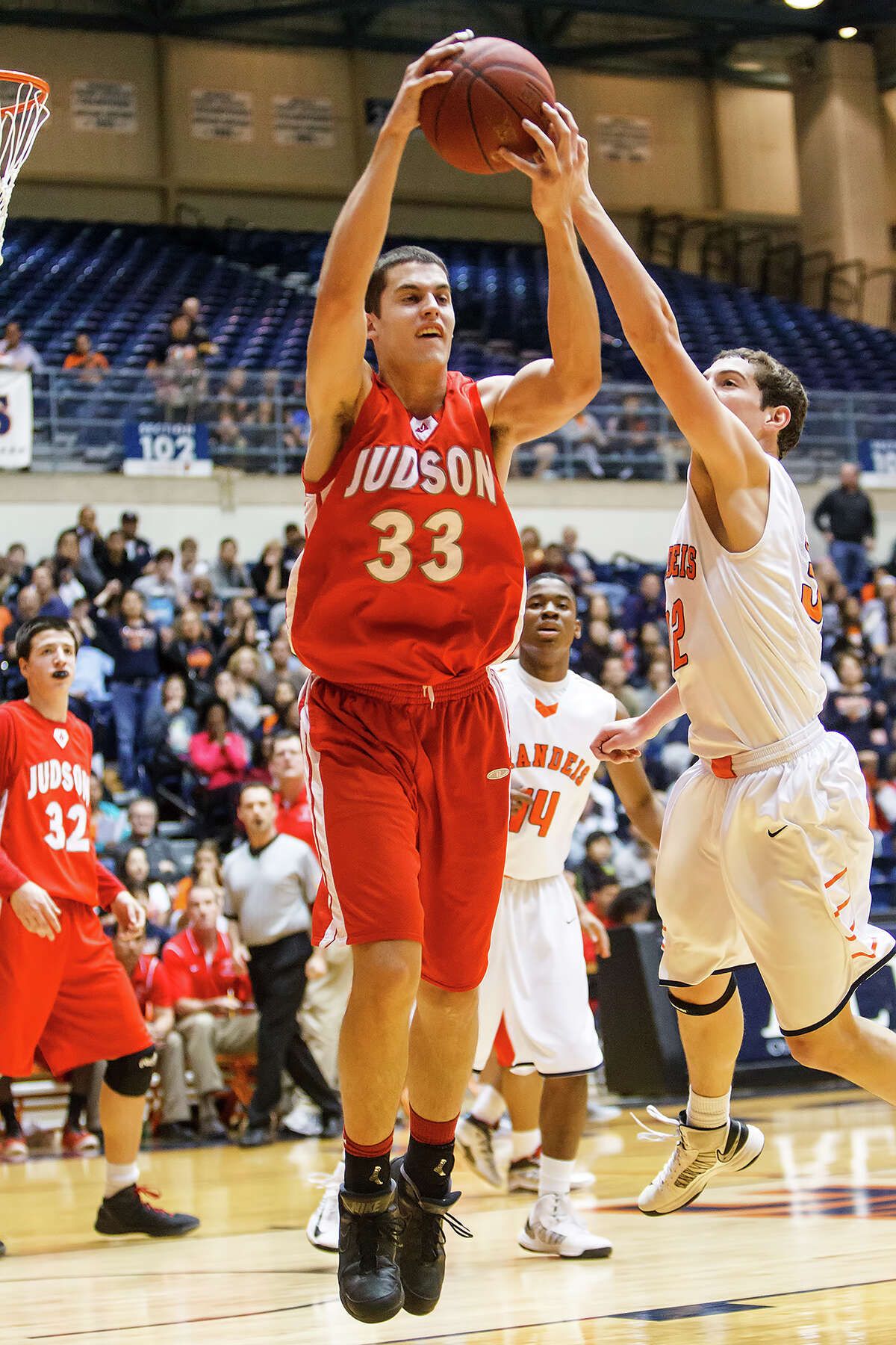 Judson's David Wacker (center) comes down with a rebound despite the efforts of Brandeis' Jared Thompson during the first half of their Class 5A boys basketball third round game at the UTSA Convocation Center on Tuesday, Feb. 26, 2013. Brandeis won the game 60-53.