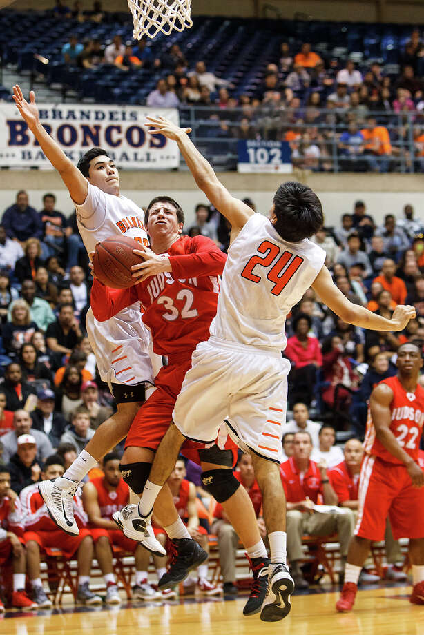 Judson's Tanner Leissner (center) tries to find a way to the basket between Brandeis' Matt Kallead (left) and Grant Huff during the second half of their Class 5A boys basketball third round game at the UTSA Convocation Center on Tuesday, Feb. 26, 2013.  Brandeis won the game 60-53. Photo: Marvin Pfeiffer, San Antonio Express-News / Express-News 2013