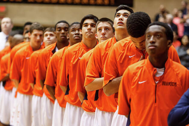 The Brandeis Broncos stand at attention as the national anthem is played prior to their Class 5A boys basketball third round game with Judson at the UTSA Convocation Center on Tuesday, Feb. 26, 2013. Photo: Marvin Pfeiffer, San Antonio Express-News / Express-News 2013
