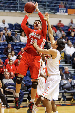 Judson's Tanner Leissner (left) shoots over Brandeis' Grant Huff during the first half their Class 5A boys basketball third round game at the UTSA Convocation Center on Tuesday, Feb. 26, 2013.  Brandeis won the game 60-53. Photo: Marvin Pfeiffer, San Antonio Express-News / Express-News 2013