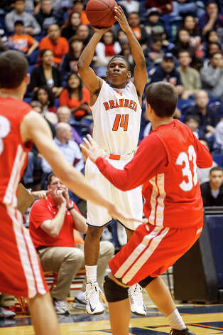 Brandeis' Larry Stephens puts up a shot during the first half of their Class 5A boys basketball third round game with Judson at the UTSA Convocation Center on Tuesday, Feb. 26, 2013.  Brandeis won the game 60-53. Photo: MARVIN PFEIFFER, Marvin Pfeiffer/ Express-News / Express-News 2013