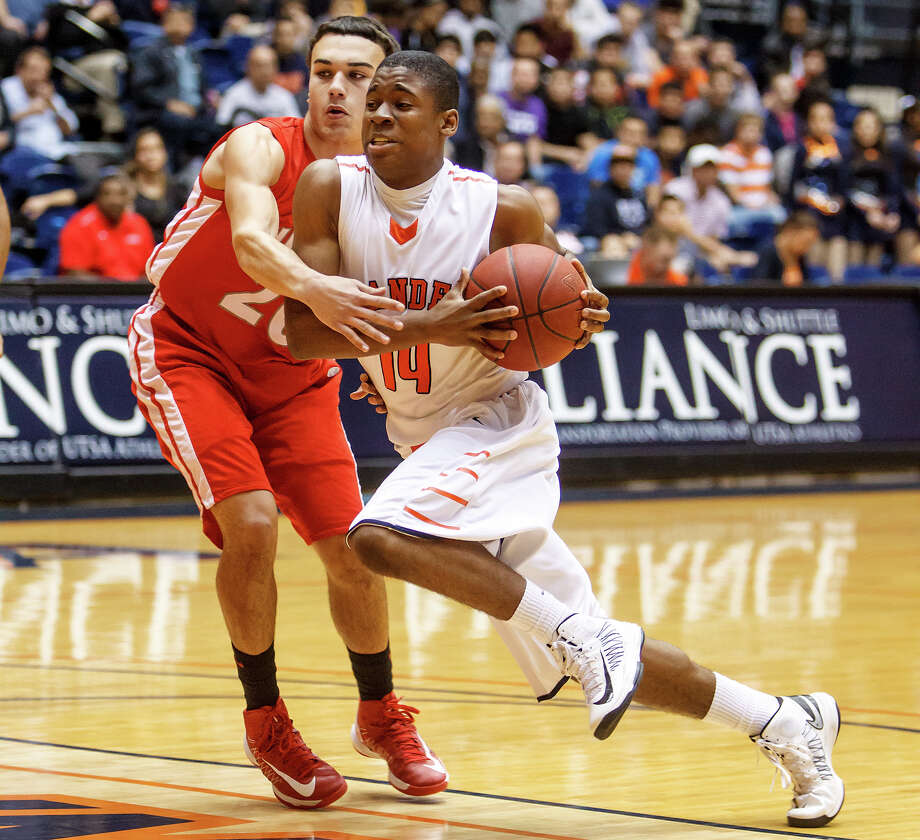 Brandeis' Larry Stephens (right) drives past Judson's Tony Allen during the first half of their Class 5A boys basketball third round game at the UTSA Convocation Center on Tuesday, Feb. 26, 2013. Brandeis won the game 60-53. Photo: Marvin Pfeiffer, San Antonio Express-News / Express-News 2013