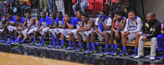 The Ozen Panthers react to the score in the final seconds of the game. The Ozen High School boys basketball team played Crosby High School at 7 p.m. Tuesday night in a Class 4A regional quarterfinal game at Lee College in Baytown. The winner of this game advances to the Class 4A Region III semifinals.  Ozen lost the game 53-50. Dave Ryan/The Enterprise Photo: Dave Ryan
