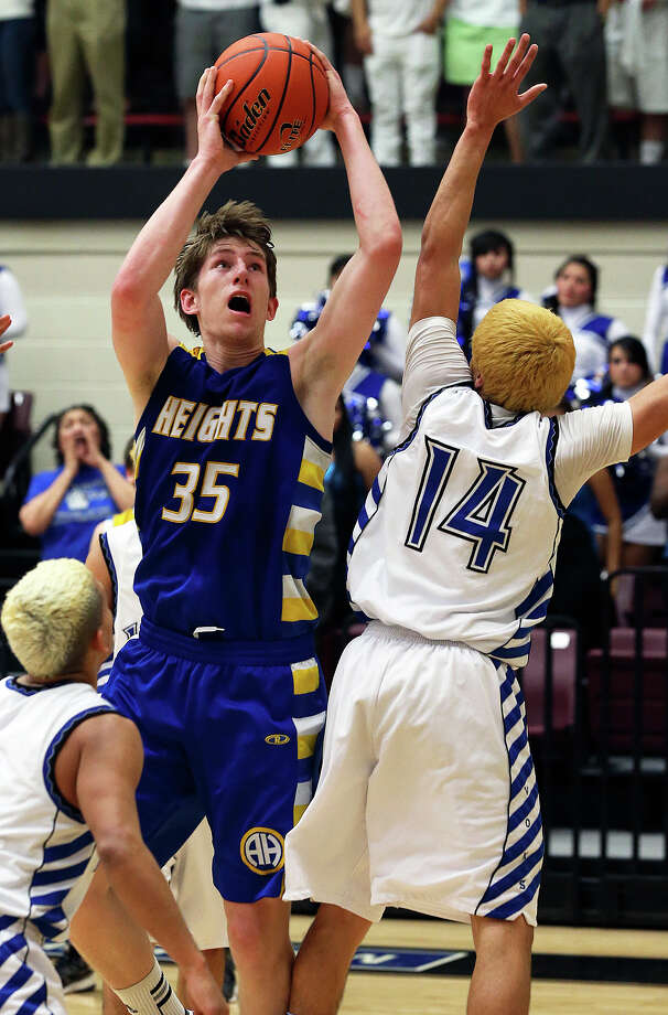 Mule forward Wes Miller takes the ball up in the lane as Alamo Heights beat Lanier in third round playoff action at Littleton Gym on February 26, 2013. Photo: TOM REEL