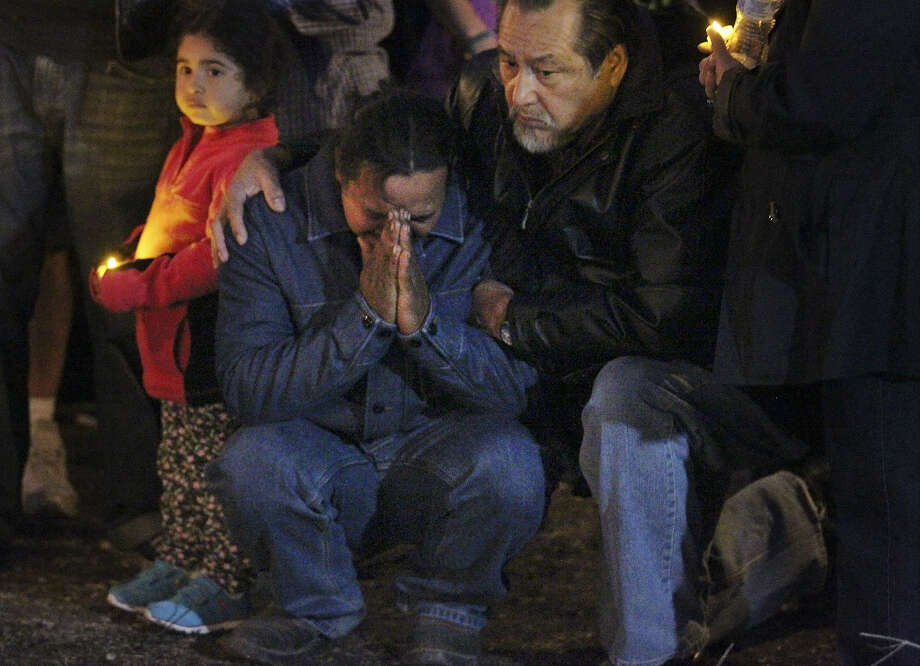 Orlin Ordonez (center), whose wife and sons died in a fire, grieves during a vigil at the site. Photo: Photos By Kin Man Hui / San Antonio Express-News