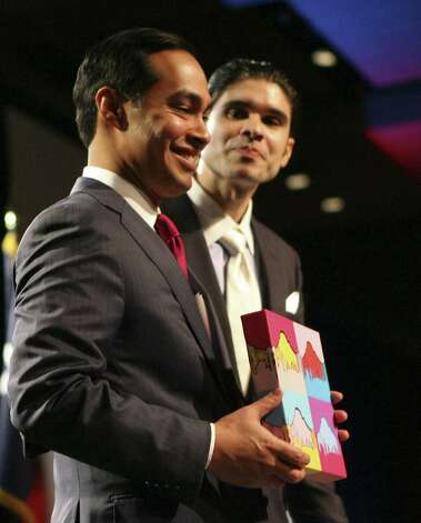 Mayor Julián Castro holds a piece of art by Andy Tiwari that was presented to him after his address. Photo: Cynthia Esparza / For The Express-News