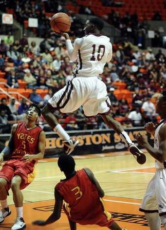 Silsbee player Chris Elam, #10, puts it up for two during the Silsbee High School Class 3A Region III quarterfinals game against Houston Yates at Sam Houston State University on Tuesday, February 26, 2013.  Yates won 100 - 85. Randy Edwards/The Enterprise Photo: Randy Edwards
