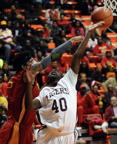 Silsbee player Zayon Jackson, #40, puts it up for two during the Silsbee High School Class 3A Region III quarterfinals game against Houston Yates at Sam Houston State University on Tuesday, February 26, 2013.  Yates won 100 - 85. Randy Edwards/The Enterprise