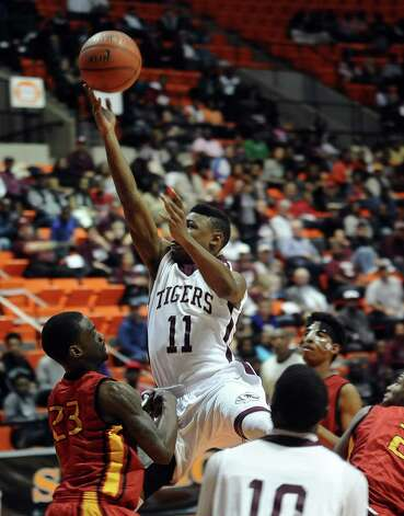 Silsbee player Jordan Holmes, #11, puts it up for two during the Silsbee High School Class 3A Region III quarterfinals game against Houston Yates at Sam Houston State University on Tuesday, February 26, 2013.  Yates won 100 - 85. Randy Edwards/The Enterprise Photo: Randy Edwards