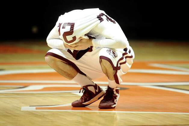 Silsbee High School player Jake Dobbins, #22, crouches on the floor with his jersey over his head after a loss in the Class 3A Region III quarterfinals game against Houston Yates High School 100 - 85.   Photo taken: Randy Edwards/The Enterprise Photo: Randy Edwards