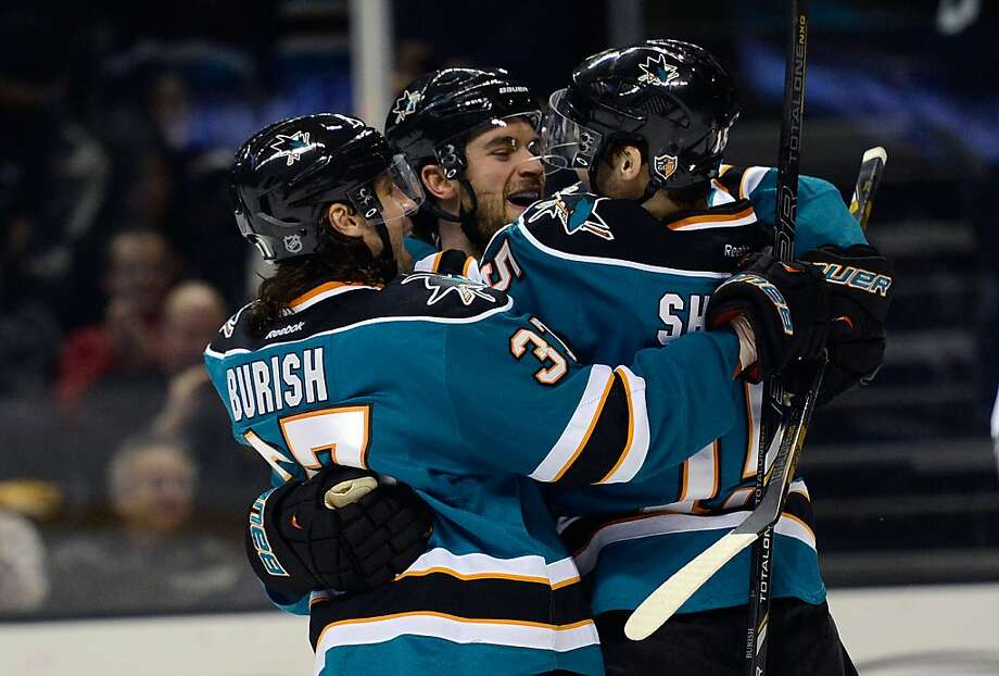 TJ Galiardi (center) gets a group hug from Adam Burish and James Sheppard after his goal. Photo: Thearon W. Henderson, Getty Images