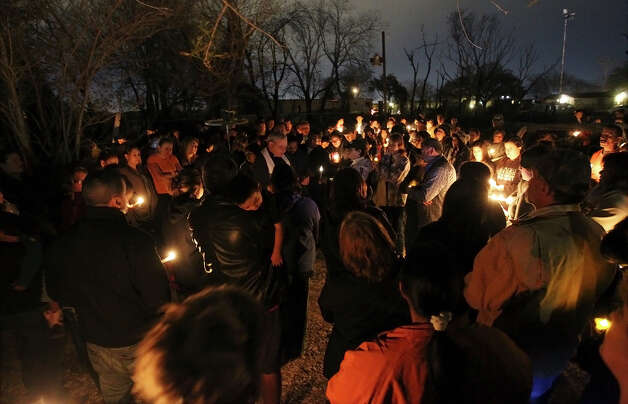 Several hundred mourners gather for a candlelight vigil for Roxanne Ordonez and her one-year-old twin sons, Daniel and Orlin, who perished in a fire on Tuesday, Feb. 26, 2013. On Monday afternoon, a fire fueled by high winds took the lives of Ordonez and her twin boys at their home off 8153 Pearsall Road. Photo: Kin Man Hui, San Antonio Express-News / © 2012 San Antonio Express-News