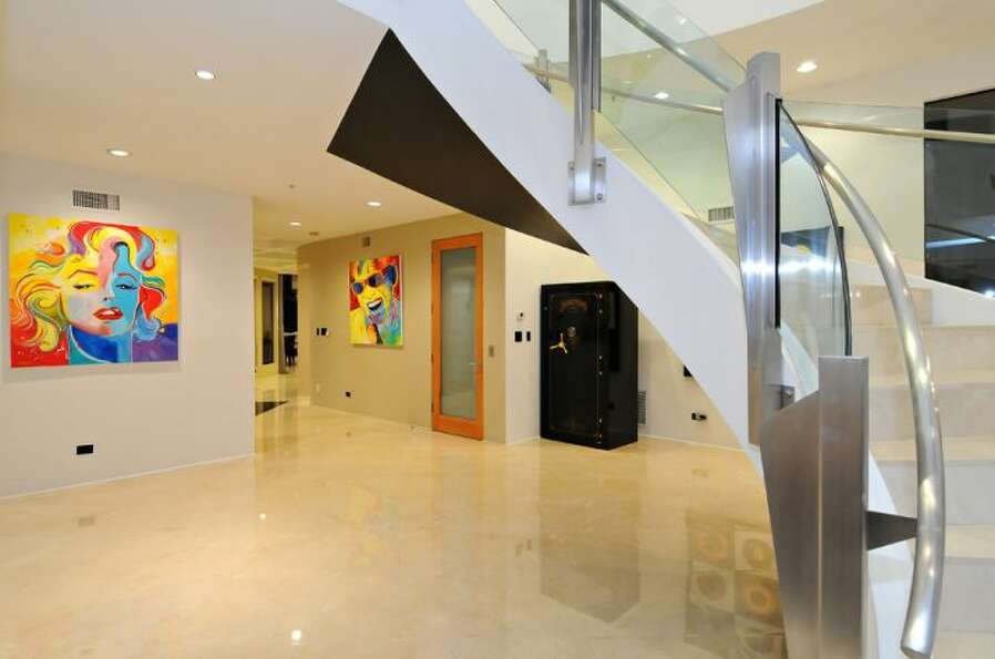 Entryway with glass staircase