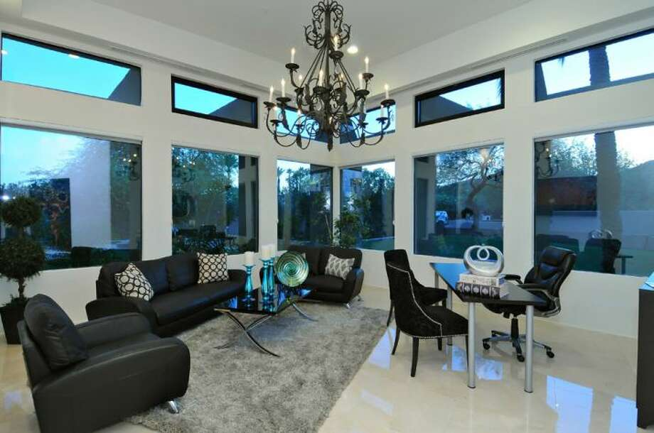 High ceilings and windows line another seating area