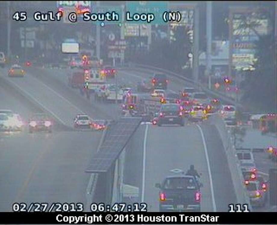 Traffic was slowed on the Gulf Freeway near the South Loop after a crash during rush hour Wednesday morning. Photo: Houston Transtar