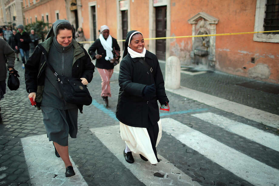 VATICAN CITY, VATICAN - FEBRUARY 27:  Nuns,  run to St Peter's Square to get prime position for Pope Benedict XVI's final general audience before his retirement on February 27, 2013 in Vatican City, Vatican. The Pontiff has held his last weekly public audience before stepping down tomorrow. Pope Benedict XVI has been the leader of the Catholic Church for eight years and is the first Pope to retire since 1415. He cites ailing health as his reason for retirement and will spend the rest of his life in solitude away from public engagements. Photo: Christopher Furlong, Getty Images / 2013 Getty Images