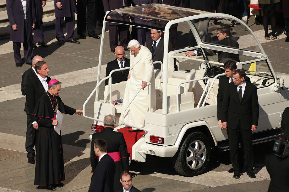 VATICAN CITY, VATICAN - FEBRUARY 27:  Pope Benedict XVI disembarks the Popemobile in St Peter's Square on February 27, 2013 in Vatican City, Vatican.  The Pontiff has attended his last weekly public audience before stepping down tomorrow. Pope Benedict XVI has been the leader of the Catholic Church for eight years and is the first Pope to retire since 1415. He cites ailing health as his reason for retirement and will spend the rest of his life in solitude away from public engagements. Photo: Oli Scarff, Getty Images / 2013 Getty Images