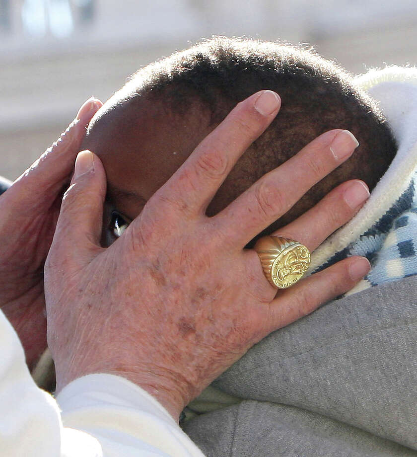 VATICAN CITY, VATICAN - FEBRUARY 27:  (EDITOR'S NOTE: Image is a cropped version of image #162790962)  Pope Benedict XVI kisses a child as he arrives in St Peter's Square for his final general audience on February 27, 2013 in Vatican City, Vatican. The Pontiff attended his last weekly public audience before stepping down tomorrow. Pope Benedict XVI has been the leader of the Catholic Church for eight years and is the first Pope to retire since 1415. He cites ailing health as his reason for retirement and will spend the rest of his life in solitude away from public engagements. Photo: Franco Origlia, Getty Images / 2013 Getty Images