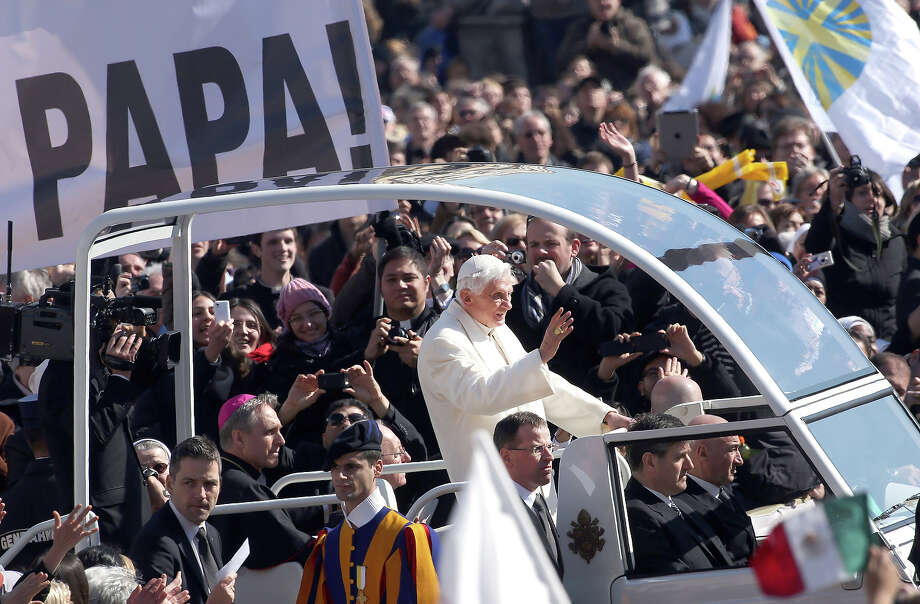 VATICAN CITY, VATICAN - FEBRUARY 27:  Pope Benedict XVI waves to the faithful as he arrives in St. Peter's Square for his final general audience on February 27, 2013 in Vatican City, Vatican. The Pontiff attended his last weekly public audience before stepping down tomorrow. Pope Benedict XVI has been the leader of the Catholic Church for eight years and is the first Pope to retire since 1415. He cites ailing health as his reason for retirement and will spend the rest of his life in solitude away from public engagements. Photo: Franco Origlia, Getty Images / 2013 Getty Images