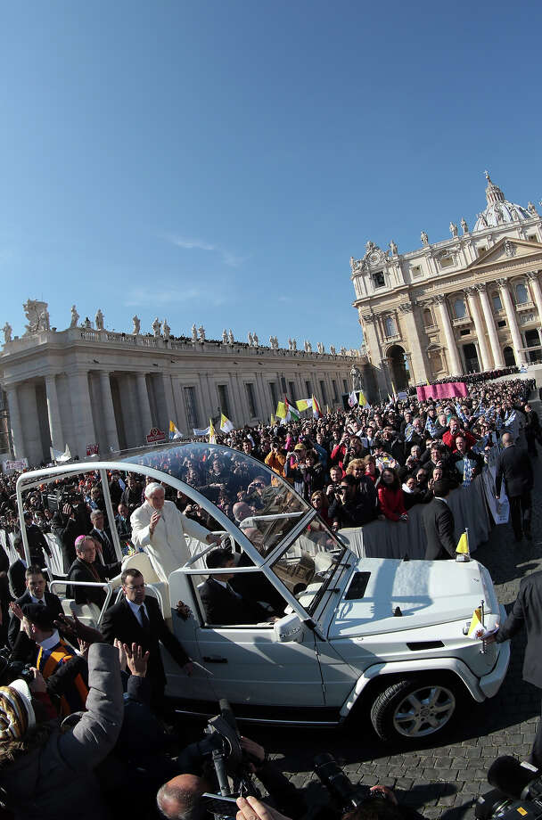 VATICAN CITY, VATICAN - FEBRUARY 27:  Pope Benedict XVI waves to the faithful as he arrives in the Popemobile at St Peter's Square on February 27, 2013 in Vatican City, Vatican. The Pontiff has attended his last weekly public audience before stepping down tomorrow. Pope Benedict XVI has been the leader of the Catholic Church for eight years and is the first Pope to retire since 1415. He cites ailing health as his reason for retirement and will spend the rest of his life in solitude away from public engagements.. Photo: Christopher Furlong, Getty Images / 2013 Getty Images