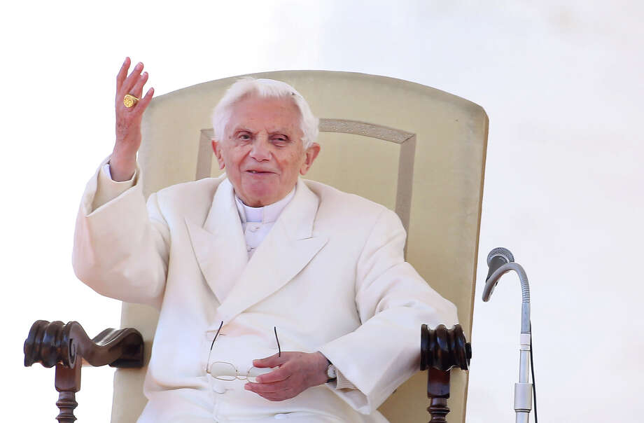 VATICAN CITY, VATICAN - FEBRUARY 27:  Pope Benedict XVI waves to the faithful gathered in St. Peter's Squareduring his final general audience on February 27, 2013 in Vatican City, Vatican. The Pontiff attended his last weekly public audience before stepping down tomorrow. Pope Benedict XVI has been the leader of the Catholic Church for eight years and is the first Pope to retire since 1415. He cites ailing health as his reason for retirement and will spend the rest of his life in solitude away from public engagements. Photo: Franco Origlia, Getty Images / 2013 Getty Images