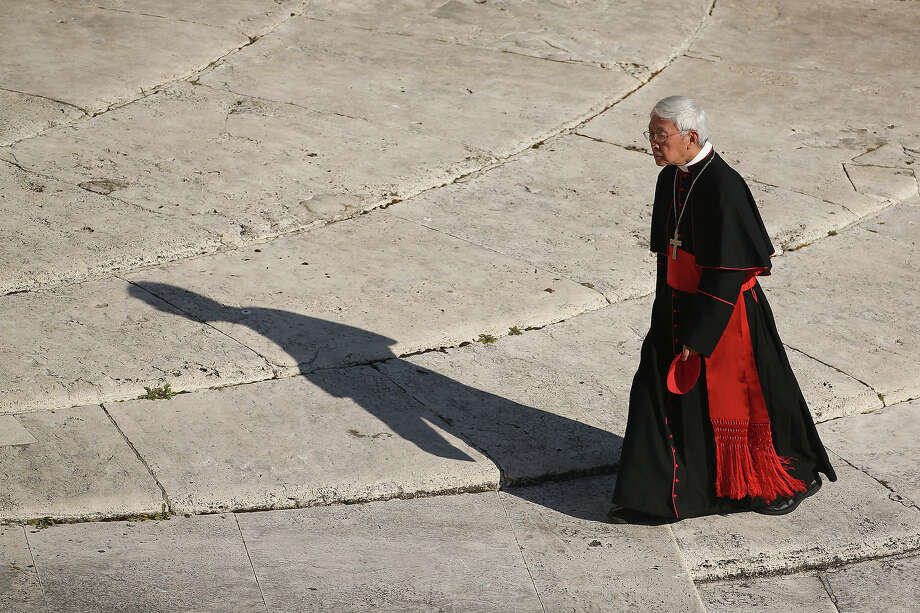 VATICAN CITY, VATICAN - FEBRUARY 27:  A cardinal arrives in St Peter's Square before Pope Benedict XVI's final weekly public audience on February 27, 2013 in Vatican City, Vatican.  The Pontiff has attended his last weekly public audience before stepping down tomorrow. Pope Benedict XVI has been the leader of the Catholic Church for eight years and is the first Pope to retire since 1415. He cites ailing health as his reason for retirement and will spend the rest of his life in solitude away from public engagements. Photo: Oli Scarff, Getty Images / 2013 Getty Images